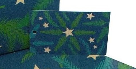 Christmas gift tag with bluey green background, pine branches and gold stars. Matches Christmas Pine needles wrapping paper.