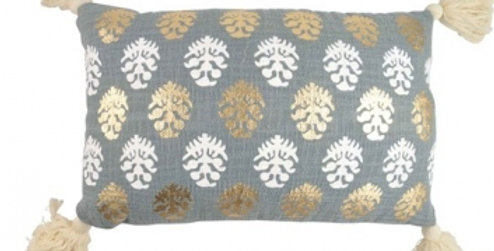 Grey cushion featuring silver and gold large leaf repeat pattern and natural tassels to four corners