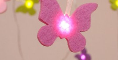 felt butterfly lights with yellow and pink perfect for kids rooms
