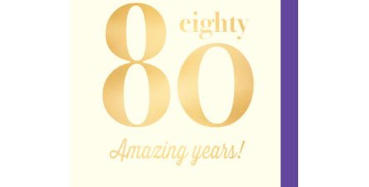 80th birthday card with a cream background and gold writing that says eighty amazing years