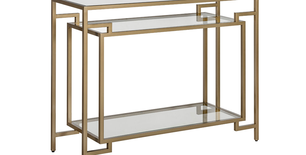 A sculptural, Art Deco style console with a burnished gold frame and tempered glass shelves. 3 levels of shelves