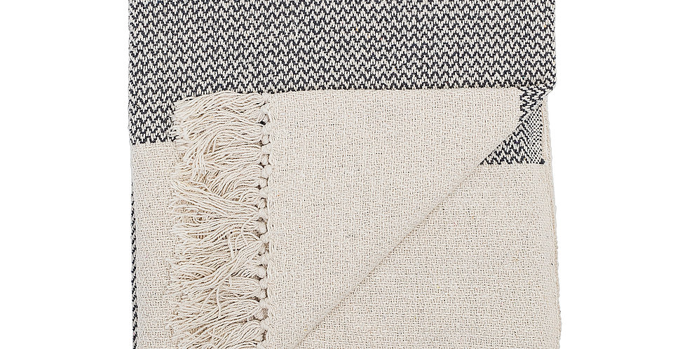 dark grey and natural cotton throw with grey wavy pattern and natural tassel edging