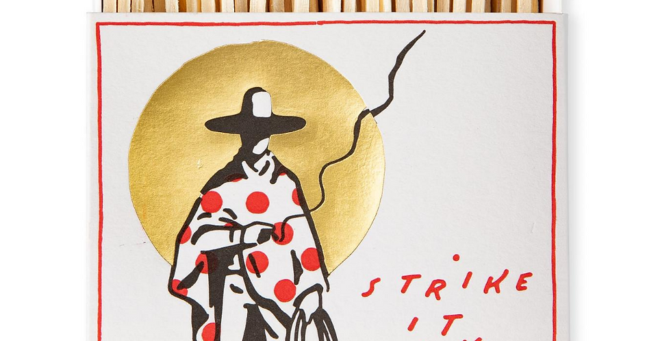 Luxury matches with cowboy illustration with cape and sombrero and wording strike it lucky