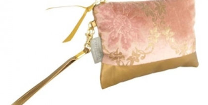 rose and gold coloured velvet make up bag features a pretty floral print and a golden handle attached to a matching gold zip