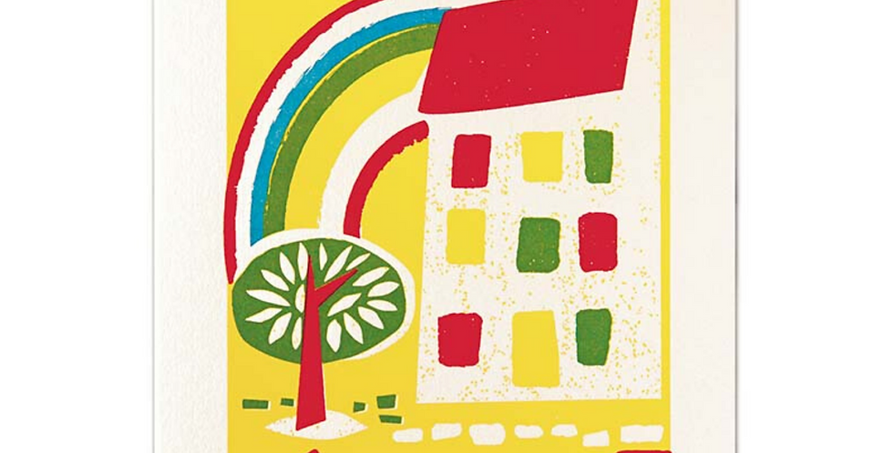 Bold & bright new home card featuring yellow, red & green colours, a house, tree & rainbow & letterpress  wording New Home