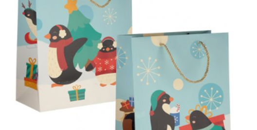 Christmas gift bags with penguins carrying a christmas tree