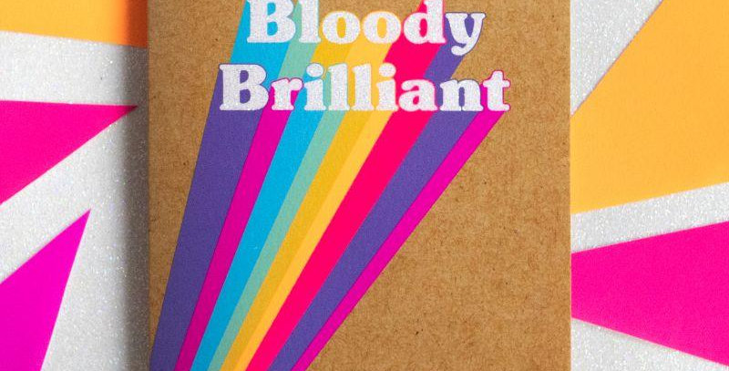 Friendship and support card. Kraft with multicoloured beams leading to white words Bloody Brilliant