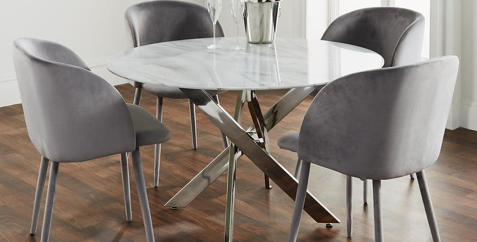 white marble topped round dining table with x shaped silver legs