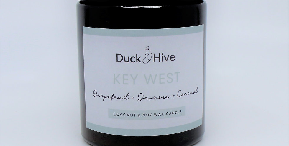 Key West soy wax candle scented with Zesty citrus, watery jasmine and creamy coconut