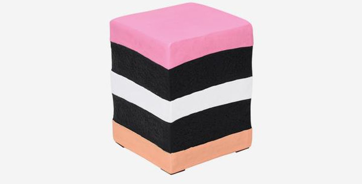 A cube stool which resembles a liquorice allsort sweet pink, white, black, peach layers of colour