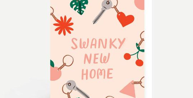 Pale peach coloured new home card with keyring pattern and words swanky new home