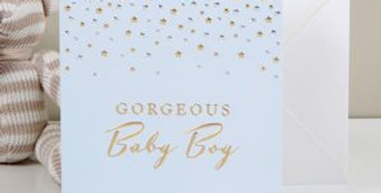 Pale blue background with gold and silver sprinkles at top and gold wording gorgeous baby boy