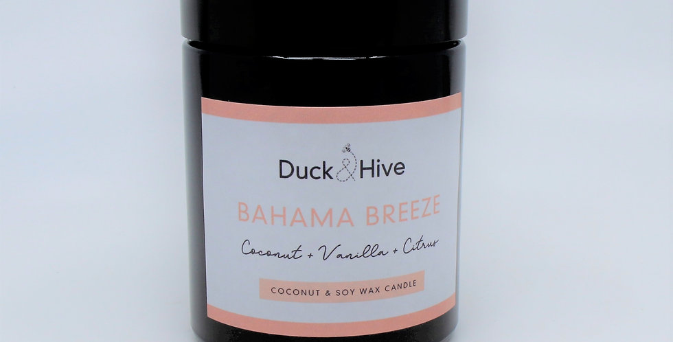 Bahama Breeze soy scented candle with fresh bergamot, sun ripened orange and rich amber with warming notes of exotic coconut,