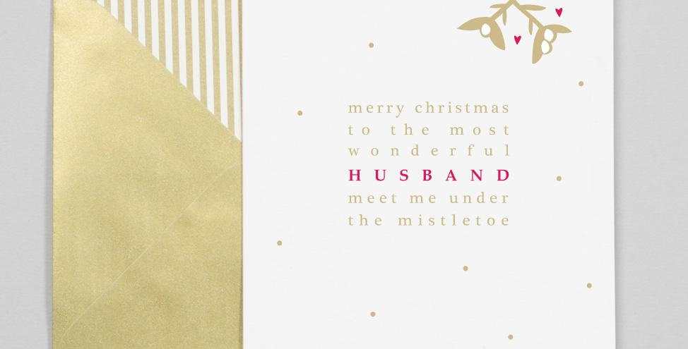 White background with gold dots red and gold tree and text saying to the most wonderful husband meet me under the mistletoe