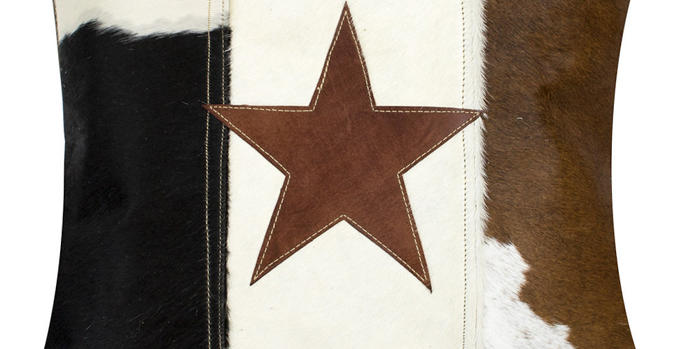 Vintage cow hide and star cushion. Black, white, tan colours featuring centred star in tan. Natural reverse.