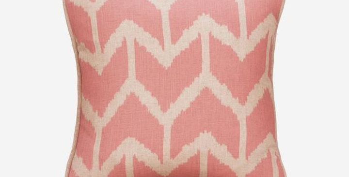 Togo pink cushion. Square with peachy pink background and off white large chevron pattern all over