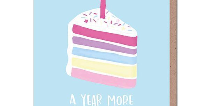 """Birthday Card with a pale blue background and a slice of rainbow cake with a candle saying """"A year more awesomer"""""""