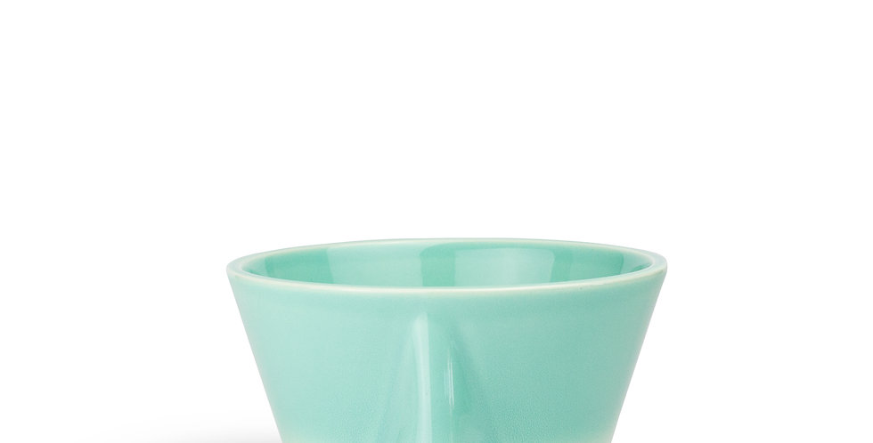 A quirky bowl that can be used as a plant pot too. It features a nose shape & graduates from a solid aqua from top to cream
