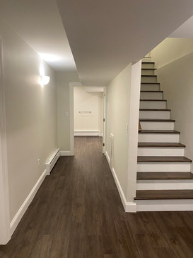 Beautiful baement remodel and Oak stairs