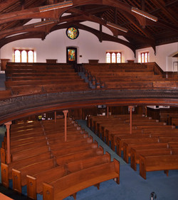 The pews above and below.