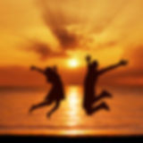 young-couple-jump-sea-beach-sunset-silho
