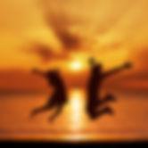 young-couple-jump-sea-beach-sunset-silho