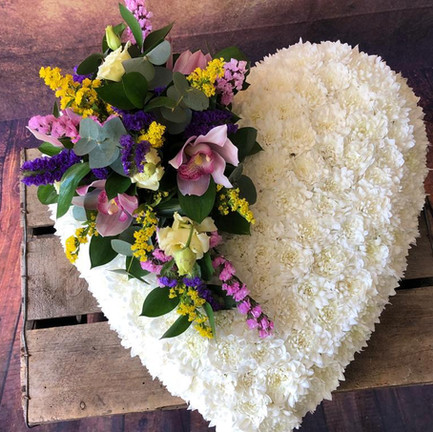 solid white heart funeral flower tribute with mixed posy.jpg