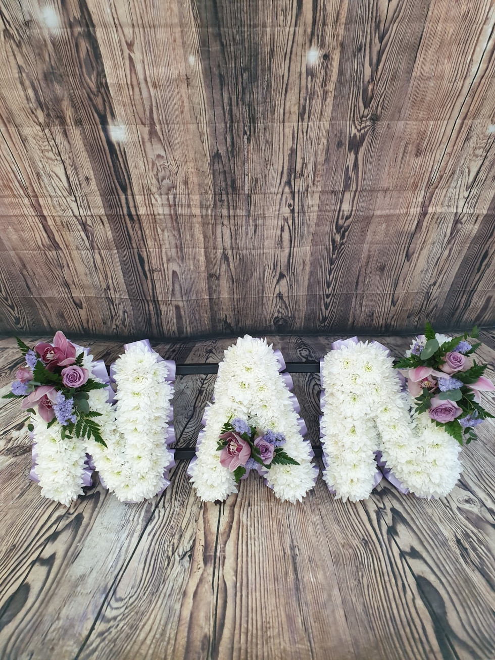 funeral letters with purple posy