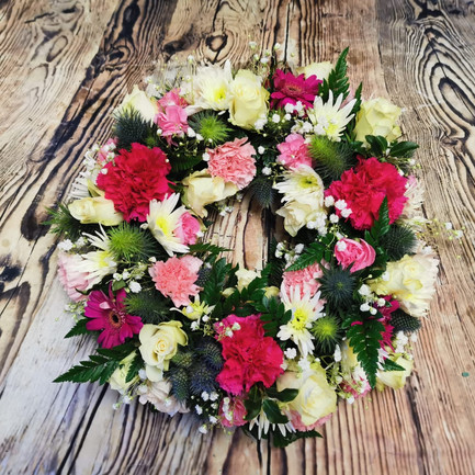 pink and white funeral wreath flower tribute.jpg