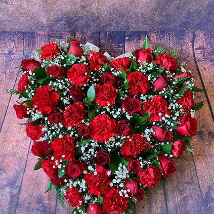 solid red rose heart funeral tribute.jpg