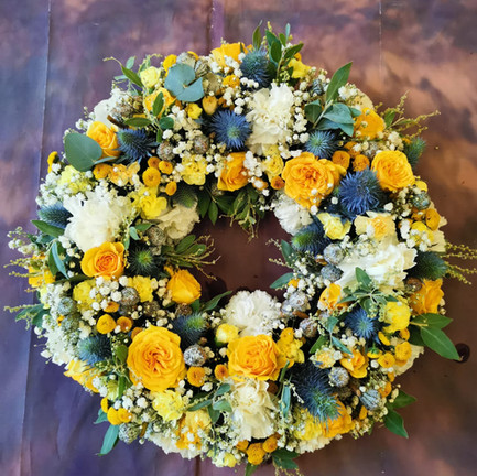 yellow and white bespoke funeral wreath tribute.jpg