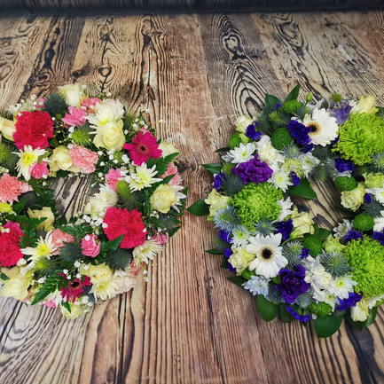 two mixed flower funeral wreath tributes.jpg