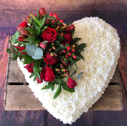 white base solid heart funeral flower tribute with red posy.jpg