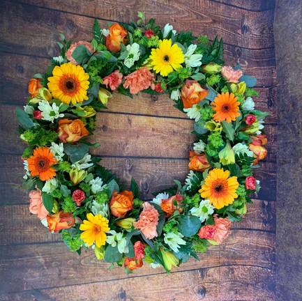 orange and yellow funeral wreath tribute.jpg