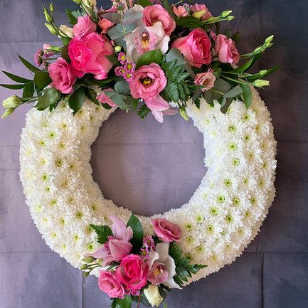 white based funeral wreath ring with pink posy tribute.jpg