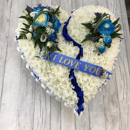 white flower funeral heart tribute with blue posy and ribbon.jpg