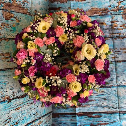 mixed flower wreath funeral tribute.jpg
