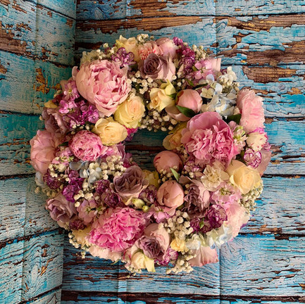 pink and cream funeral wreath tribute.jpg