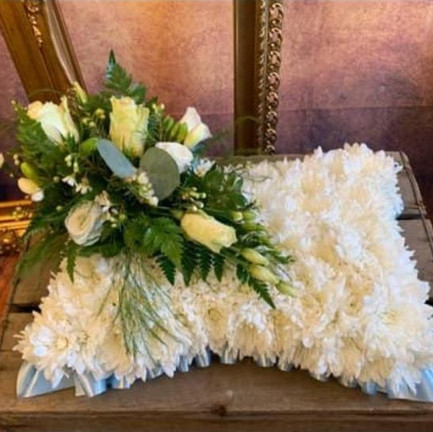 white flower funeral cushion tribute with white posy.jpg