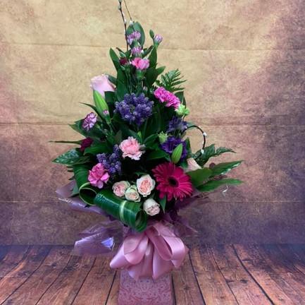 Pink and Purple tall aqua flower bouquet.jpg