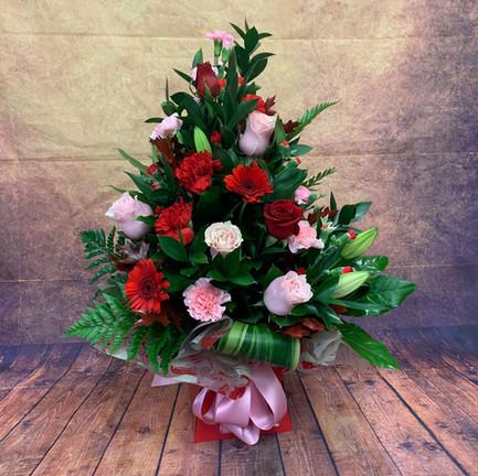 red and pink tall aqua flower bouquet.jpg