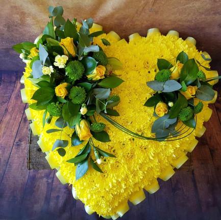 yellow solid heart funeral flower tribute.jpg