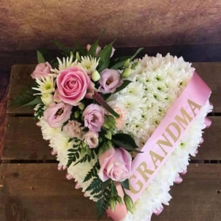 white solid heart funeral flower tribute with pink posy and ribbon.jpg