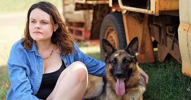 Highway of Lost Hearts - Mot sitting with her dog