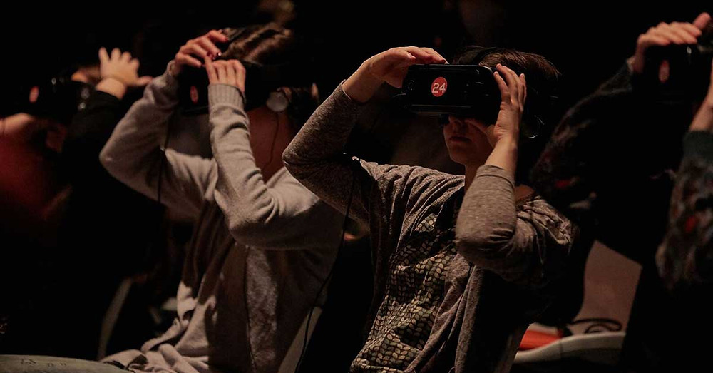 Audience weasring virtual reality goggles