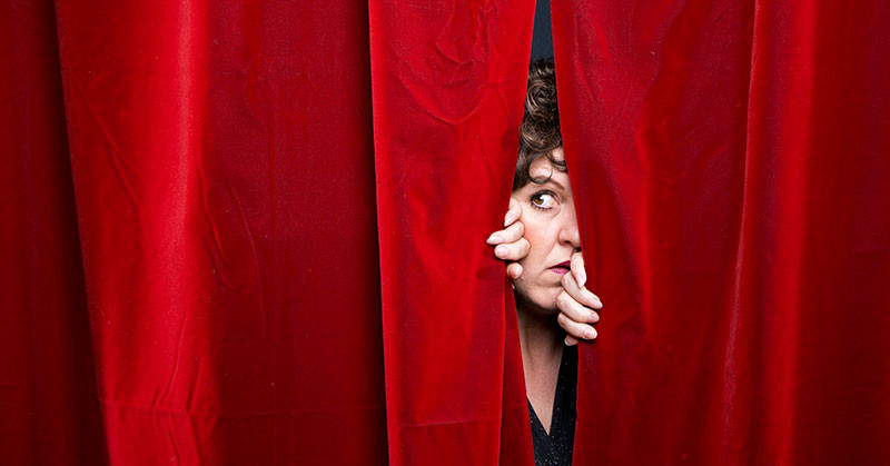 Jan van de Stool parting a red curtain