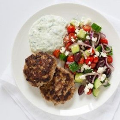 Greek Turkey Burger Patties with Tzatziki Sauce & Greek Salad .