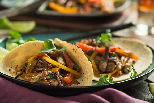Skillet fajitas with pork, peppers and onions