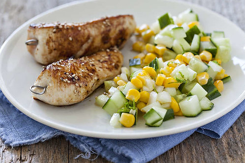 Sesame chicken skewers with corn and cucumber salad