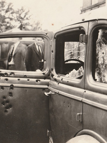 The bullet riddled car following the police ambush. Bonnie & Clyde went down in a hail of lead.